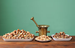 Hazelnuts in a bowl and metal vessel Royalty Free Stock Images