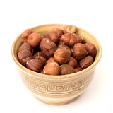 Hazelnuts. In a bowl on a white background Stock Image
