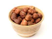 Hazelnuts. In a bowl on a white background Royalty Free Stock Photography