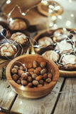 Hazelnuts on bowl on wooden table top views Stock Photo