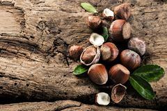 Hazelnuts on brown wooden background close up. royalty free stock images