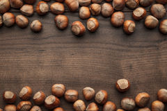 Hazelnuts on the brown wooden table Royalty Free Stock Photos
