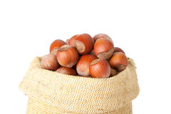 Hazelnuts in a burlap bag on white background Royalty Free Stock Photography