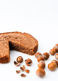 Hazelnuts cake. Genuine hazelnuts cake with cracked nuts and a white background. Typical Italian recipe Royalty Free Stock Photos