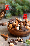 Hazelnuts with chocolate and cinnamon in a wooden bowl. Royalty Free Stock Photos