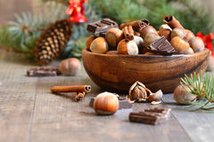 Hazelnuts with chocolate and cinnamon in a wooden bowl. Stock Images