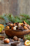 Hazelnuts with chocolate and cinnamon in a wooden bowl. Stock Image
