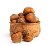 Hazelnuts close -up in a wooden bowl Royalty Free Stock Photography
