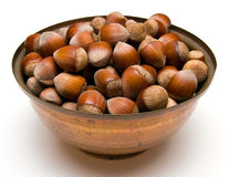 Hazelnuts in a copper bowl Stock Image