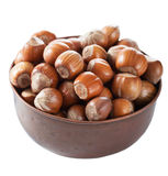 Hazelnuts in copper bowl isolated Royalty Free Stock Image
