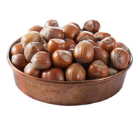 Hazelnuts in copper bowl isolated Stock Photos