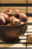 Hazelnuts in a cup. Hazelnuts in a bronze cup Stock Photography