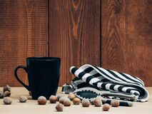 Hazelnuts and cups  Stock Photography