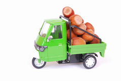 Italian Ape toy car with nuts Stock Photos