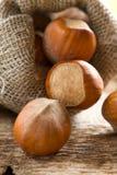 Hazelnuts (filbert). On the wood Royalty Free Stock Photography