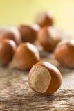 Hazelnuts (filbert). On the wooden table Stock Photos