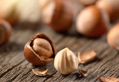 Hazelnuts, filbert on old wooden background Royalty Free Stock Photography