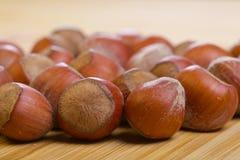 Hazelnuts, filbert on old wooden background. Bunch of hazelnuts, filbert on old wooden background Stock Photos
