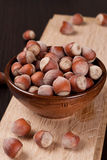 Hazelnuts, filbert on old wooden background Stock Photos