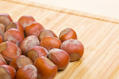 Hazelnuts, filbert on old wooden background. Empty Royalty Free Stock Image