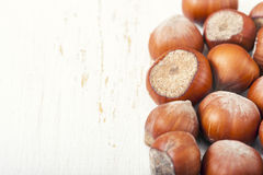 Hazelnuts, filbert on old wooden background. Selective focus Stock Photos