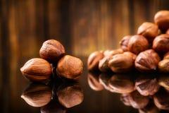 Hazelnuts, filbert on wooden background. Selective. Raw Organic Hazelnuts, filbert on old wooden background Stock Photography
