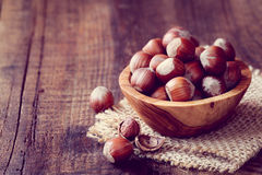 Hazelnuts. Filtered image of Hazelnuts in a wooden bowl on rustic background Stock Photography