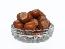 Hazelnuts in a glass bowl Royalty Free Stock Photography