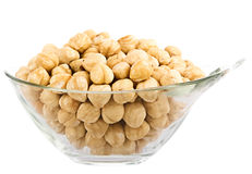 Hazelnuts in glass piala. Isolation on white background Stock Images