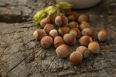 Hazelnuts. On a old wooden background Stock Photos