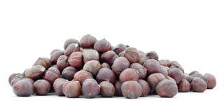 Hazelnuts, heap isolated on white background Royalty Free Stock Images