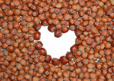 Hazelnuts and heart shaped copy space Royalty Free Stock Images