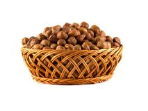 Hazelnuts with leaves in a wooden basket isolated on white background Royalty Free Stock Image