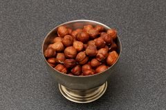 Hazelnuts in metal bowl Stock Images