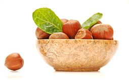 Hazelnuts and mint leaves in a bowl Royalty Free Stock Image