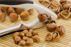 Hazelnuts. Nutcracker hulling and hazelnuts with shells, close-up Stock Photo
