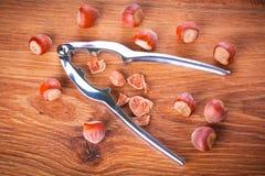 Hazelnuts with nutcracker Royalty Free Stock Photo