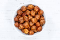 Hazelnuts nuts from above bowl wooden board. Wood Stock Photos