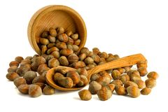 Hazelnuts nuts of Turkish hazel. The concept of hazelnut nuts as. Money earnings of dolars. Isolate on white background, copy space stock photo