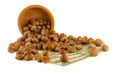 Hazelnuts nuts of Turkish hazel. The concept of hazelnut nuts as. Money earnings of dolars. Isolate on white background, copy space stock photos