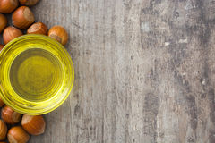 Hazelnuts oil on wood. En background Royalty Free Stock Photography