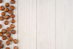 Hazelnuts on a old wooden table. Abstract background, empty temp Royalty Free Stock Image