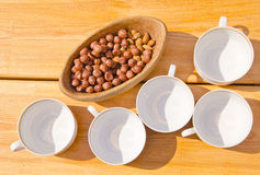 Hazelnuts pack in wooden dish cups placed on table Stock Images