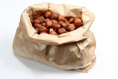 Hazelnuts in the paper bag Stock Photo