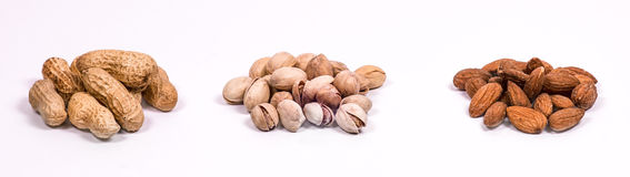 Hazelnuts, pistachios and almonds Stock Photo