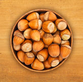 Hazelnuts in pot Stock Images