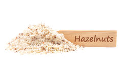 Hazelnuts powdered and plate Stock Image