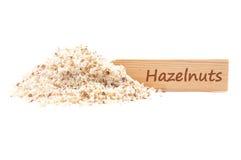 Hazelnuts powdered and plate Stock Image