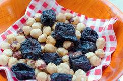 Hazelnuts and prunes. In bowl Stock Photos