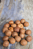 Hazelnuts on rustic background Royalty Free Stock Images